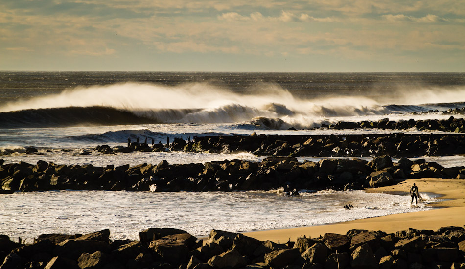 Lone surfer in West End, NJ going out for another epic ride. Photo: Christor Lukasiewicz
