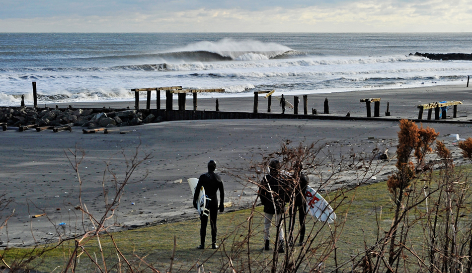 "Serenity amongst the devastation. Such is the case along the New Jersey Shore since Hurricane Sandy hit. For a brief moment, NJ surfers were able to forget about the devastation. Photo: <a href=""http://jerseyshoreimages.com/about.html\"">Robert Siliato</a>"