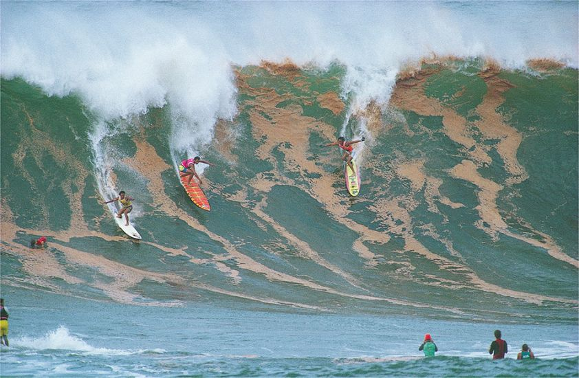 "1988. Dennis Pang, Marvin Foster and Mark Foo at Waimea Bay. Photo: <a href=""http://www.artbrewer.com\"" target=_blank>Art Brewer</a>"