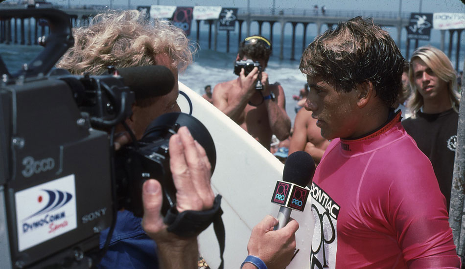 "A young Kelly Slater takes a post-heat interview at the OP Pro. Photo <a href=""http://www.aspworldtour.com\"">courtesy of the ASP</a>"