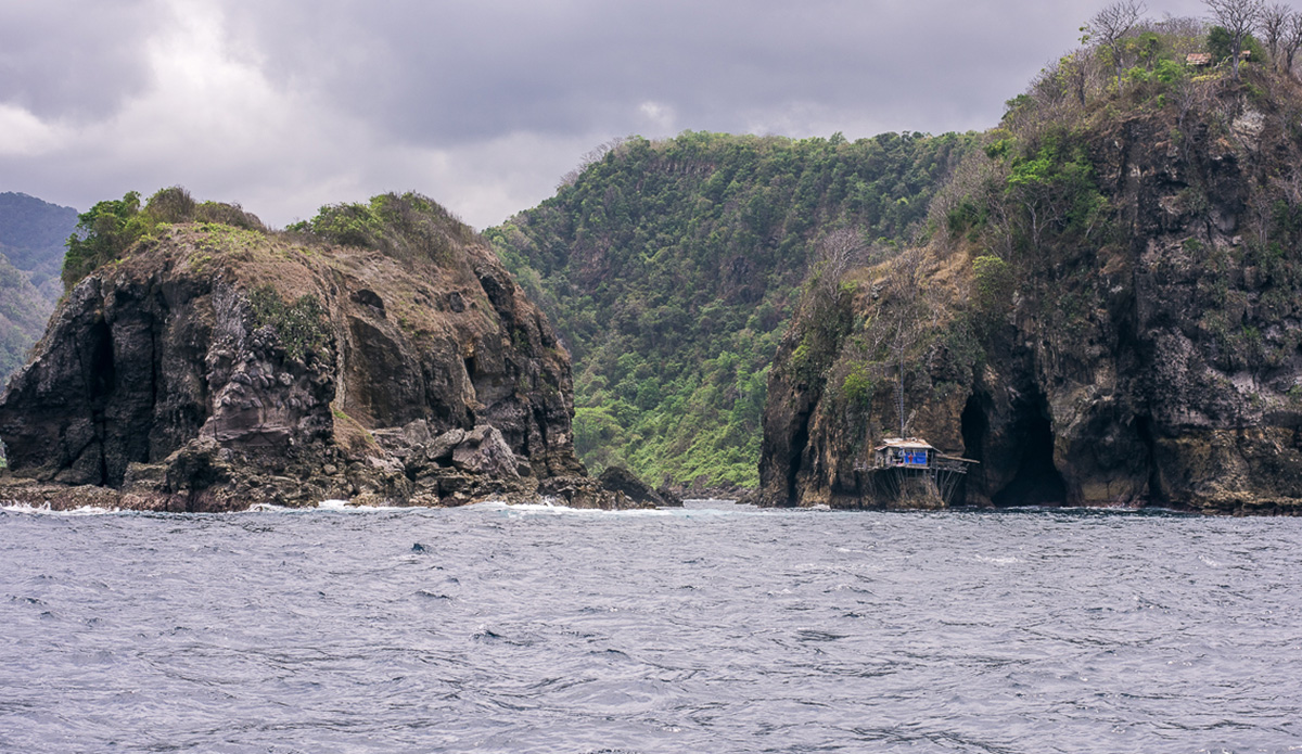 This is the most remote house I've ever seen. If you look closely, there's actually another house on top of the cliff with wooden ladders as access between the two places. The man living here has to have one of the best oceanfront views in the world. Photo: Austin Robertson