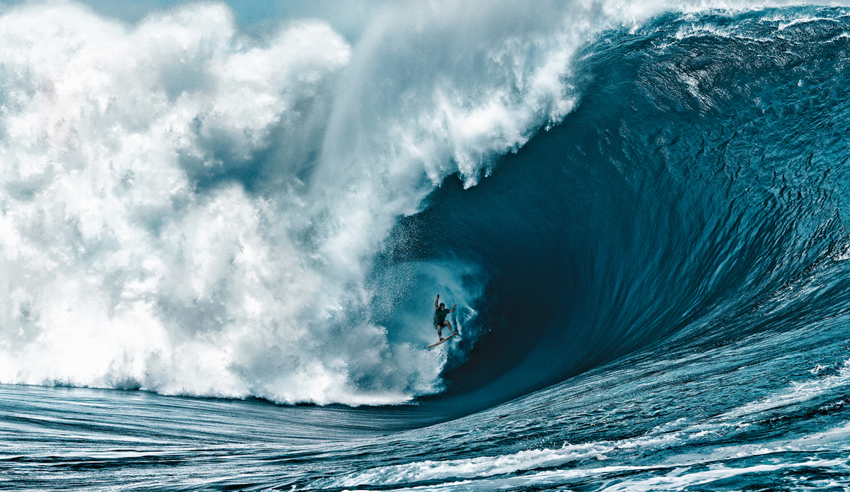 "Nathan Fletcher at Teahupoo in Tahiti on the code red swell. This is the craziest wave ever ridden by a human. Yes he survived. Photo: <a href=""http://www.brianbielmann.com\"">Brian Bielmann</a>"