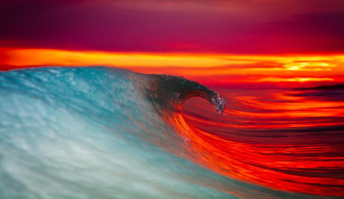 "Juxtaposition of color at sunset.  A-frame Outer Banks. Photo: <a href=\""https://www.surferphotos.com\"">Graham Hunt</a>"