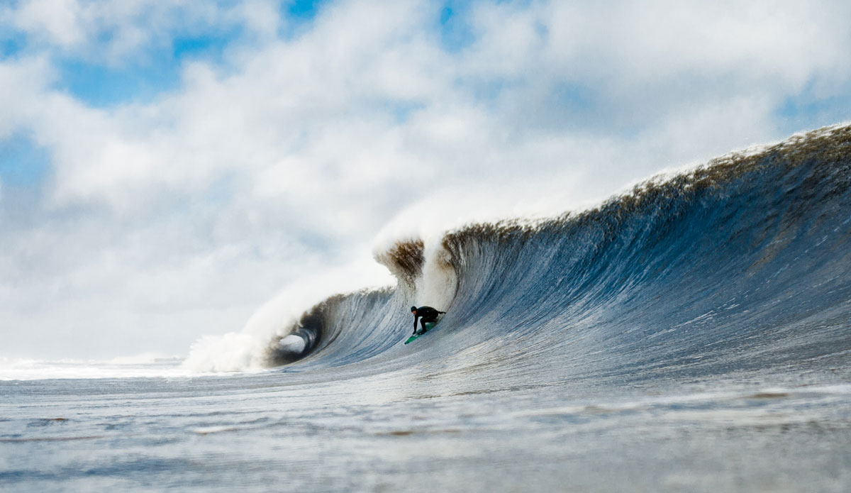 "Sam Hammer. ""This is probably one of my favorite photos to date. Sam dropping into a freight train left the week after the Dooms Day swell here in New Jersey. You can fit a full size SUV in the tube right behind him and a small school bus into the sections he's on."" Photo: <a href=""http://cargocollective.com/ryanmackphoto""> Ryan Mack</a>"