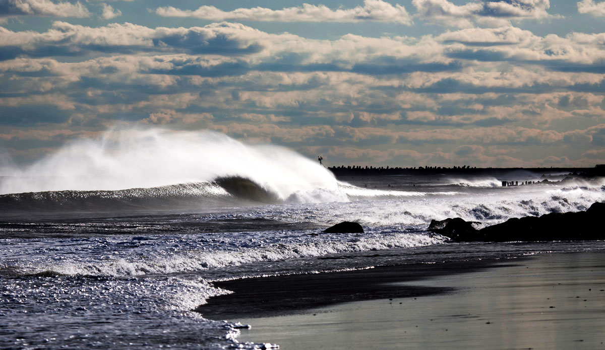 """Manasquan Inlet, NJ. """"This photo is one of my favorite lineup photos I've ever taken. I just love the big spray going over the back of the wave from the offshore winds and the glowing light effect in the shore break."""" Photo: <a href=""""http://www.mikeincittiphotography.com/""""> Mike Incitti.</a>"""