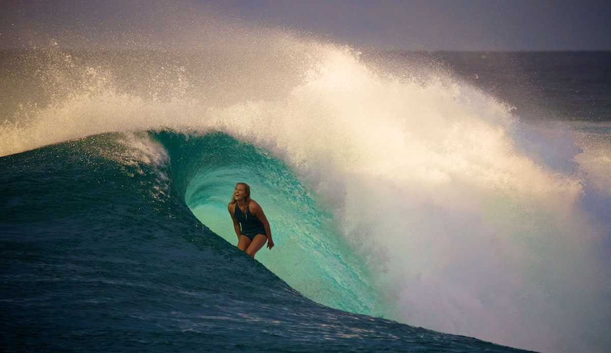 """Stephanie Gilmore at P-Pass. This is one of those moments that just happen. The rain stopped, the clouds parted and the sun burst through just as Steph took off….she pulled into a nice little barrel and as she came out the lip flared…The delight on her face is genuine, this is not her working the camera, she didn't even know that I had this shot until later. Photo: <a href=""""http://richardkotchphotography.com/"""">Richard Kotch</a>"""