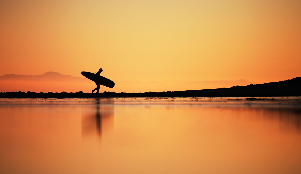 """""""The walk out   after a long day can be one of the most satisfying parts of surfing."""" Photo:<a href=""""http://www.paulgreenephoto.com/""""> Paul Greene.</a>"""