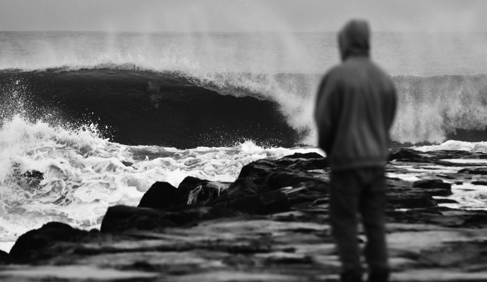 "Surfer contemplating whether it\'s worth it to run back to the truck and put on the 5 mil. Photo: <a href=""http://jerseyshoreimages.com/about.html\"">Robert Siliato</a>"