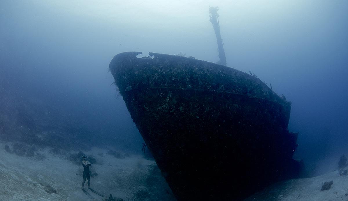 "Alexey Molchanov standing at 110 feet, looking up at the Aguila wreck off Roatan, Honduras. Photo: <a href=\""http://liabarrettphotography.com/\"" target=_blank>Lia Barrett</a>"