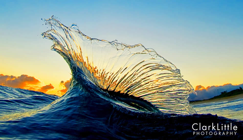 "Backwash wave hits an incoming wave, throwing a glass arch into the sunrise colors. National Geographic used this as a two page spread last summer. The Limited Edition print sold out quickly. Photo: <a href=""http://ClarkLittlePhotography.com\"" target=_blank>Clark Little</a>."