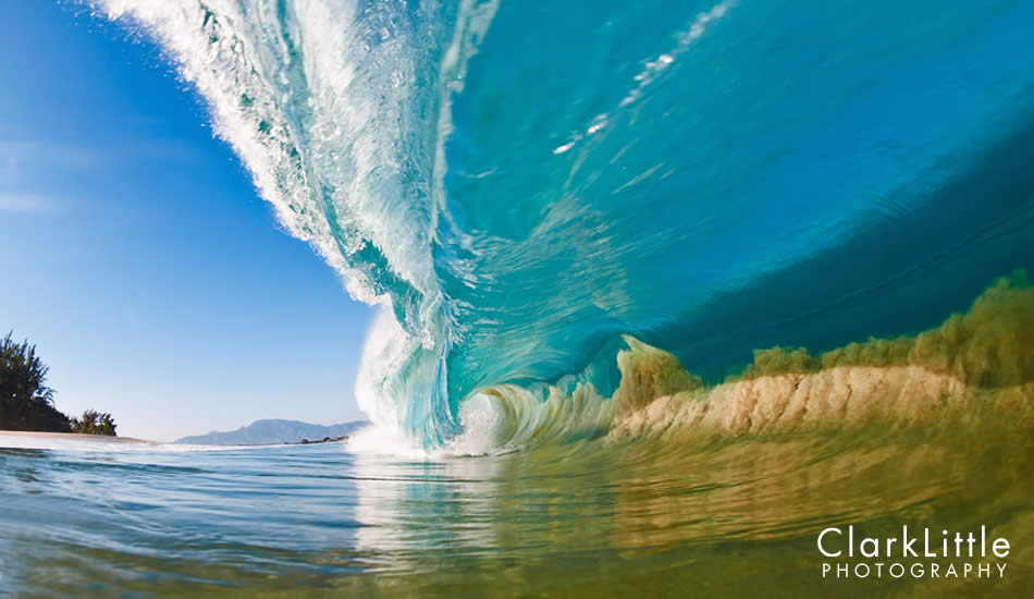 """A large North Shore wave makes its way into a shallow sand bank, sucking the sand off of the sea floor into the wave itself. Photo: <a href=\""""http://ClarkLittlePhotography.com\"""" target=_blank>Clark Little</a>."""