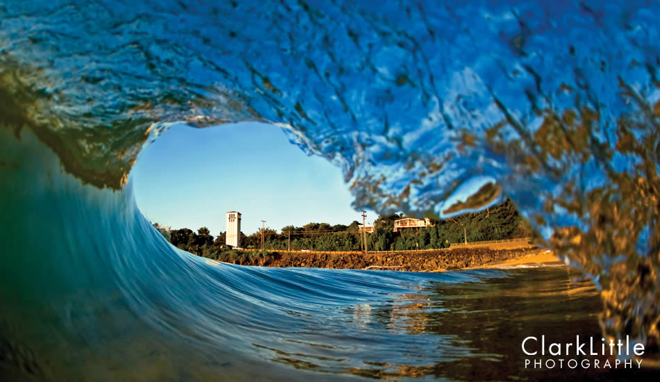 "Waimea Bay shorebreak with the iconic church tower framed in the tube. It all began with surfing this wave. The surfboard morphed into a camera. Photo: <a href=""http://ClarkLittlePhotography.com\"" target=_blank>Clark Little</a>."