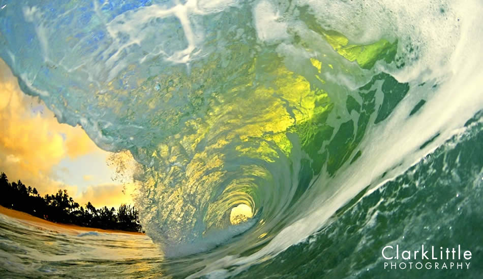 """Backlit during the sunset, the wave turns green. Photo: <a href=\""""http://ClarkLittlePhotography.com\"""" target=_blank>Clark Little</a>."""