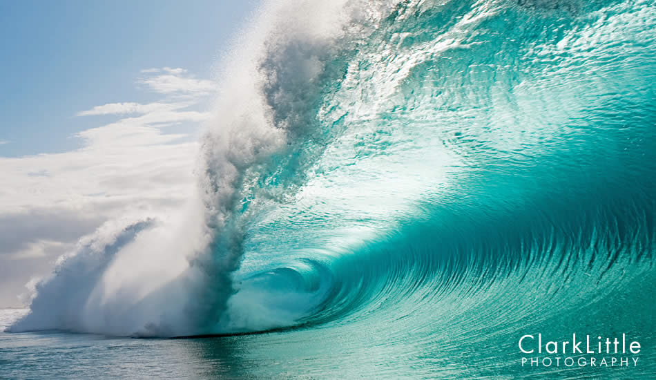 """People often mistake this wave for Pipe, which is about ¼ mile away. The colors are different since there is not reef below this wave. Photo: <a href=\""""http://ClarkLittlePhotography.com\"""" target=_blank>Clark Little</a>."""