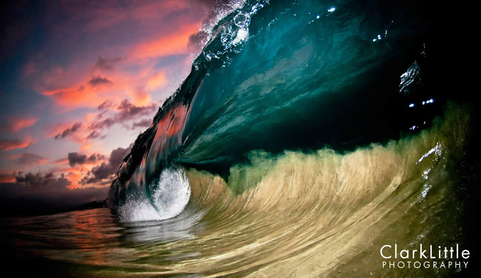 """Where the light from the strobe flash ends, the remnants of the sunset colors fill in. Notice the sand getting pulled into the wave face helping to define the wave. Photo: <a href=\""""http://ClarkLittlePhotography.com\"""" target=_blank>Clark Little</a>."""