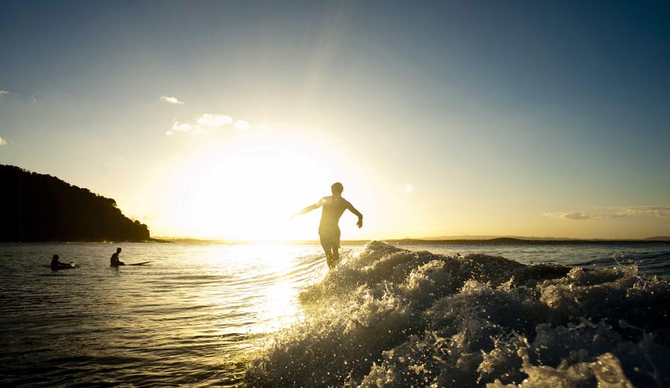 "Luke Potter gliding into the sunset at Tea Tree Bay. Photo: <a href=\""http://www.jackdekortphoto.com/\"">Jack Dekort</a>"
