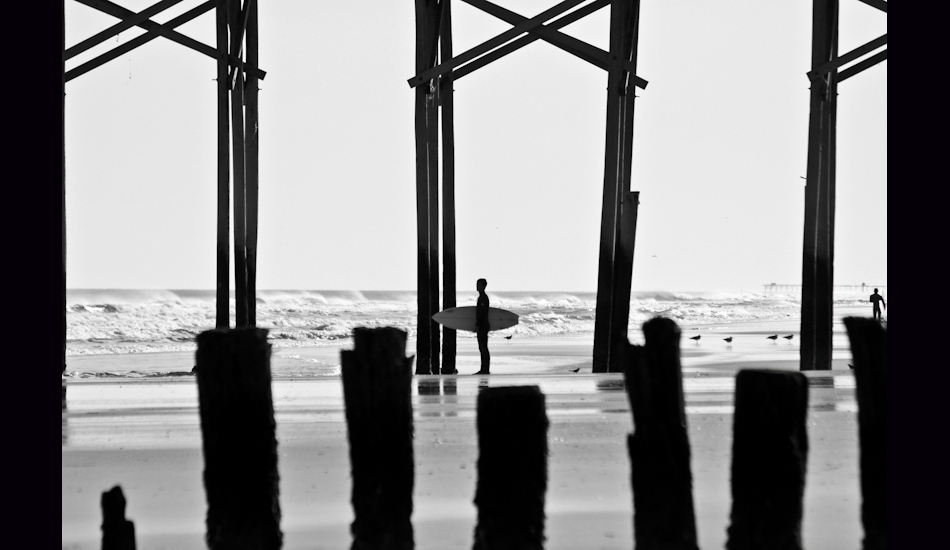"Carolina Beach, NC, 2011. A lonesome surfer paddles out to catch swell at a local spot called ""Sunskipper\"". Photo: <a href=\""http://www.chrisfrickphotography.com/\"" target=_blank>Chris Frick</a>"