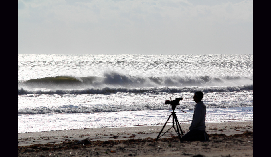 "S Turns, OBX, NC, 2011. Joe Cheshire contemplating weather to surf or film. He shortly packed up his equipment and choose to surf. Photo: <a href=""http://www.chrisfrickphotography.com/\"" target=_blank>Chris Frick</a>"