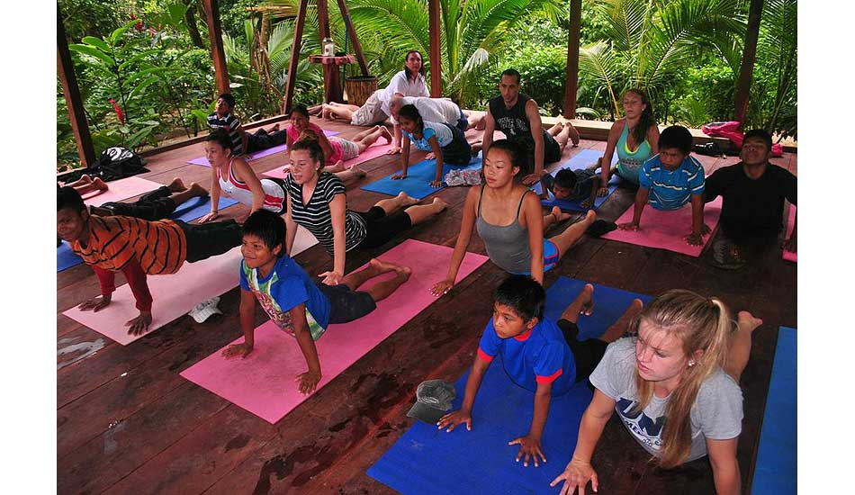 """Yoga class. Photo: <a href=\""""http://giveandsurf.org/\"""">Give and Surf</a>"""