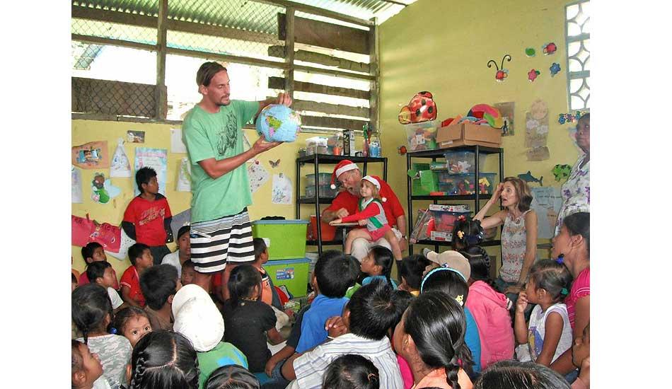 "Explaining where Santa lives. Photo: <a href=\""http://giveandsurf.org/\"">Give and Surf</a>"