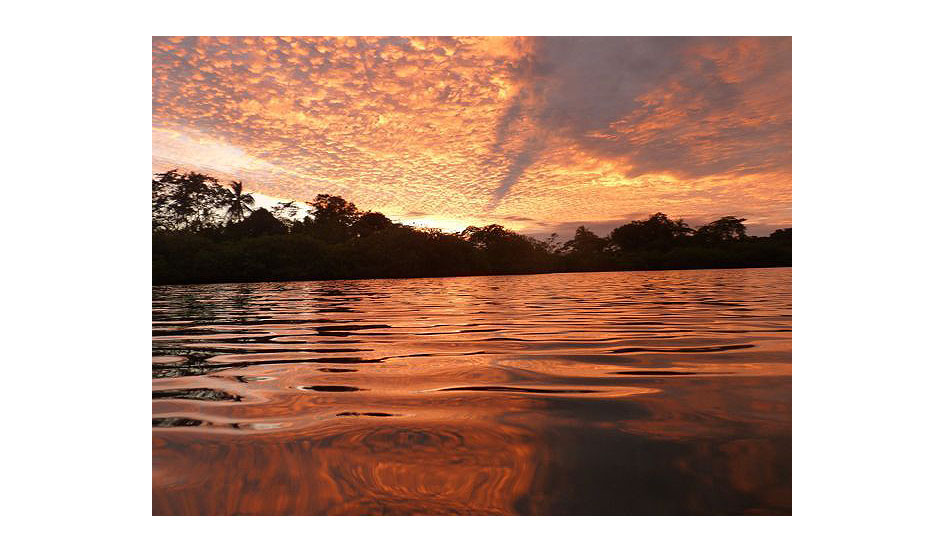 """Sunset in the bay. Photo: <a href=\""""http://giveandsurf.org/\"""">Give and Surf</a>"""