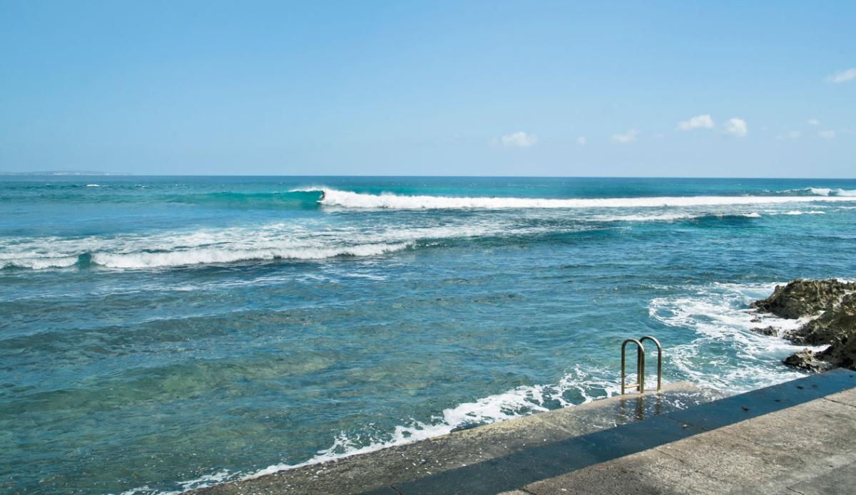 """This surf spot gave new meaning to the term """"step-offs"""". The break is right in front of tiered concrete steps that lead directly down to the water's edge, creating a public amphitheater for watching the action and affording ridiculously easy access for paddling out. Photo: <a href=\""""http://www.justinjay.com\"""" target=\""""_blank\"""">Justin Jay</a>"""