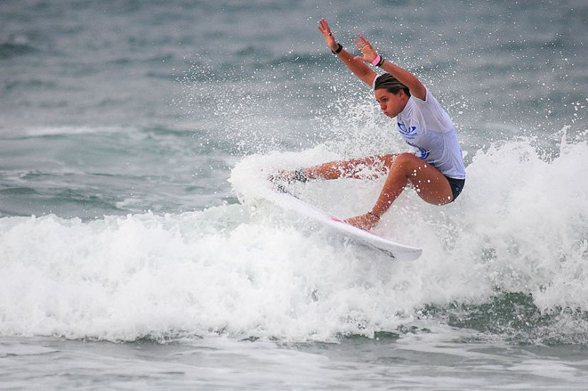ISA China Cup Women\'s Open Division winner Philippa Anderson slashes her way to victory. Photo: ISA/Tweddle