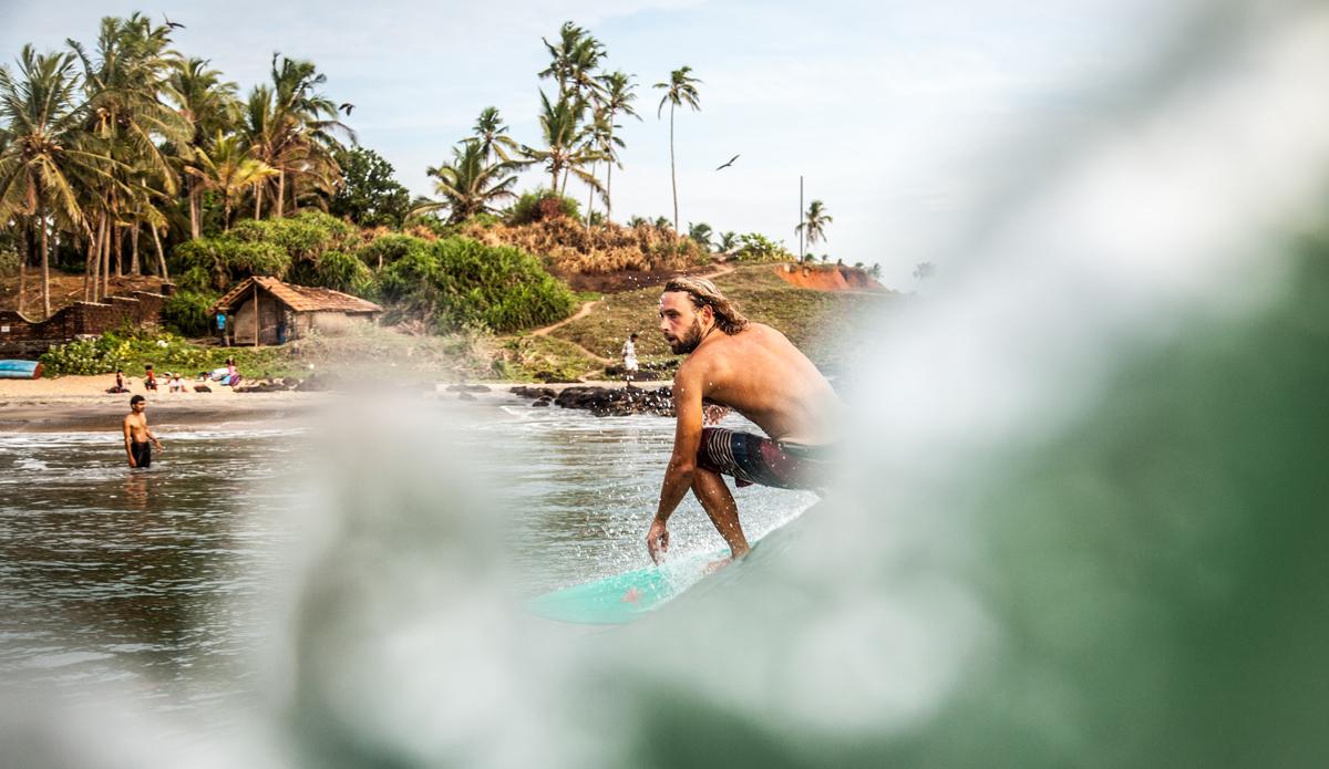 "Joshua surfing in Edawa beach. Photo: <a href=\""http://www.Godoberta.com\"">GodoBerta.com</a>"