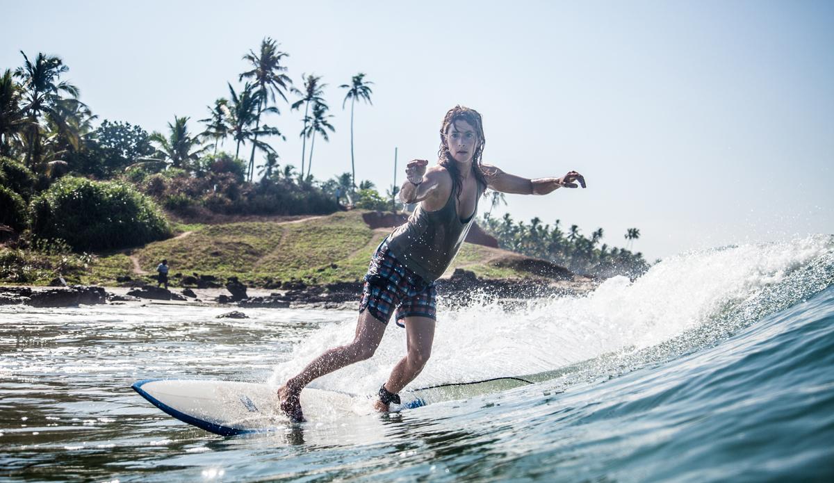 "Lucy surfing after her Yoga classes. Photo: <a href=\""http://www.Godoberta.com\"">GodoBerta.com</a>"