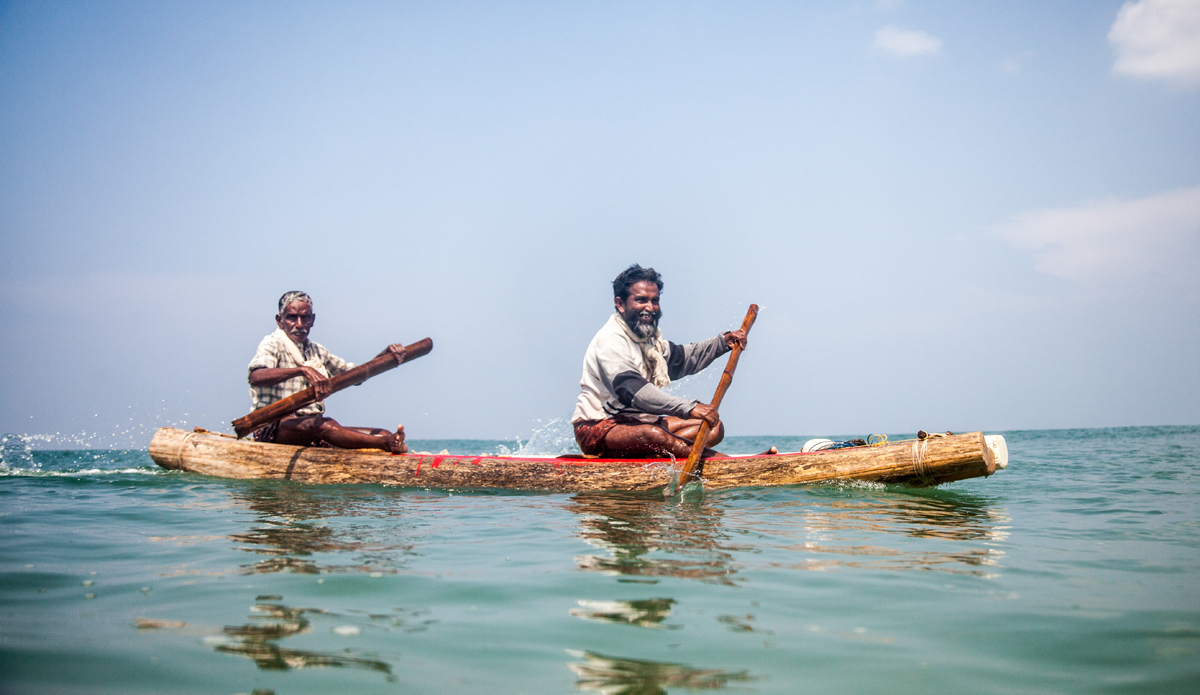 """Fishermen are coming back from the ocean. Their small traditional boat is made from three wooden planks. They are tied together before going to fish and dissembled after coming back. Photo: <a href=\""""http://www.Godoberta.com\"""">GodoBerta.com</a>"""