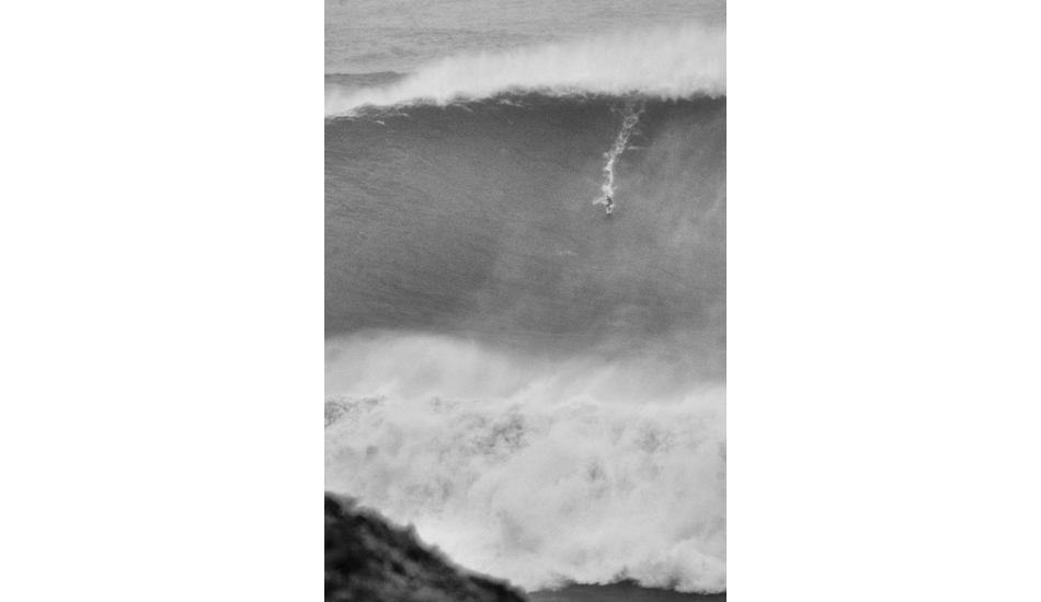 "As I decided to take a tight shot, the biggest wave ever surfed turned up and Carlos Burle surfed it just after saving Maya from certain death. Photo: <a href= ""http://joaobracourt.com/\"" target=_blank>Joao Bracourt.</a>"