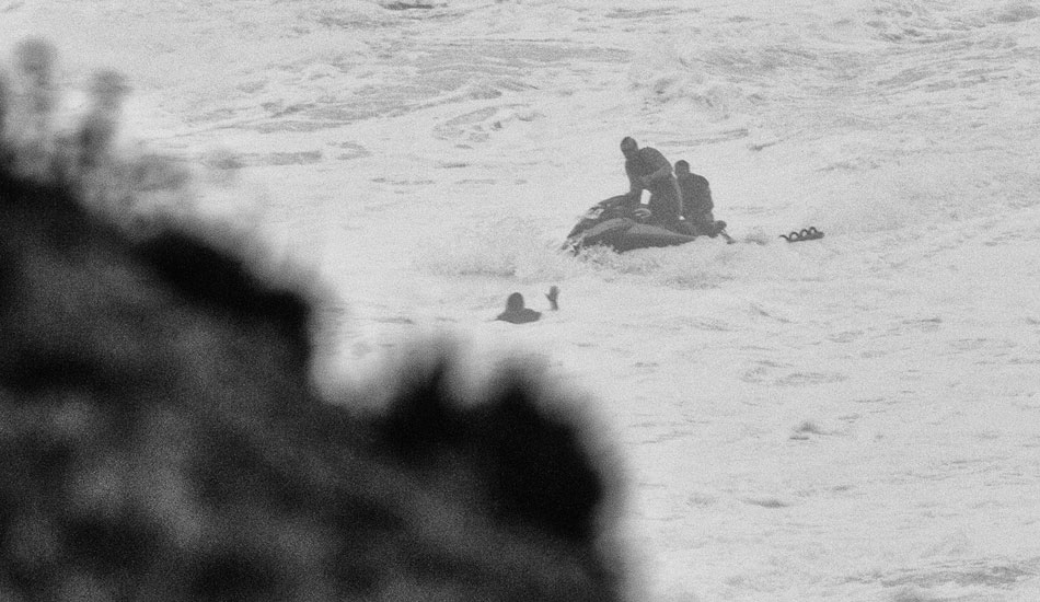 "Carlos being rescued himself. Photo: <a href= ""http://joaobracourt.com/\"" target=_blank>Joao Bracourt.</a>"