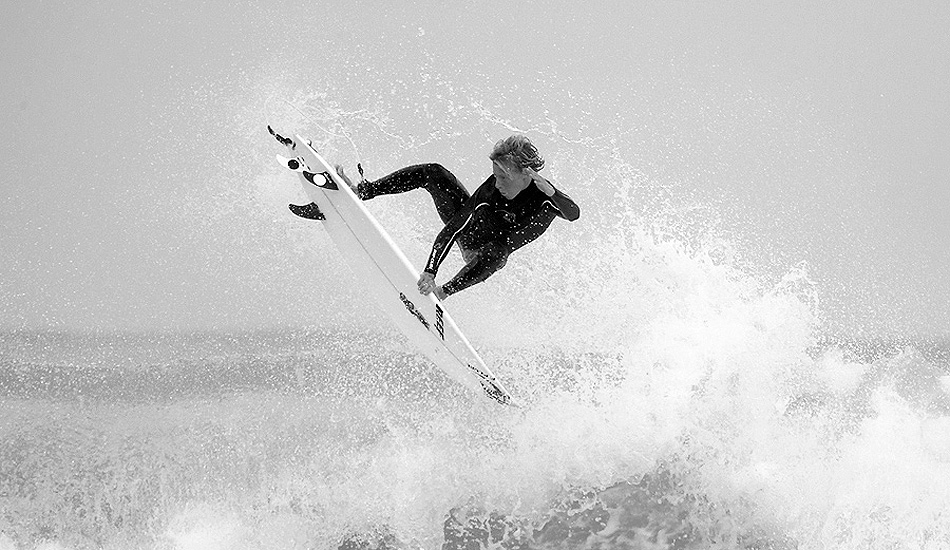 "British surfer, Jayce Robinson, grabs the rail at his local beach break in Cornwall. Photo: <a href=""http://www.jordanweeks.com/\"" target=_blank>Jordan Weeks</a>"
