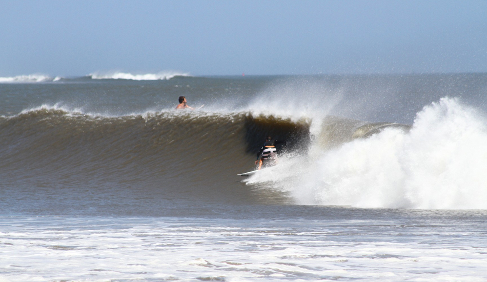 Ben Bourgeois. Ben was completely plugged in with ocean's energy while surfing Oregon Inlet.You can see the outer shoals breaking in the distance. Image: McCarthy
