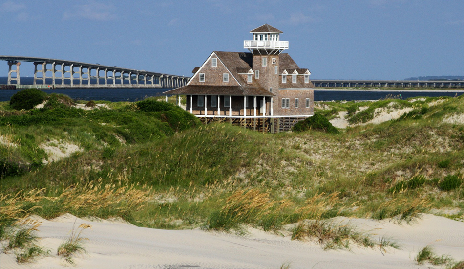 Old Coast Guard Station, Oregon Inlet. It was just refurbished after years of being abandoned. That's the Bonner bridge in the background, the true gateway to Outer Banks surfing. Image: McCarthy