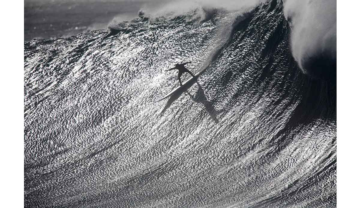 "Chilean big wave surfer Ramon Navarro shadow dances a big drop at Waimea Bay, Hawaii. This was the first time I had seen Waimea Bay break as 40-foot rollers hit the reef. It was one of the best days of my career. Photo: <a href=""http://www.luciagriggi.com\"" target=\""_blank\"">Lucia Griggi</a>"
