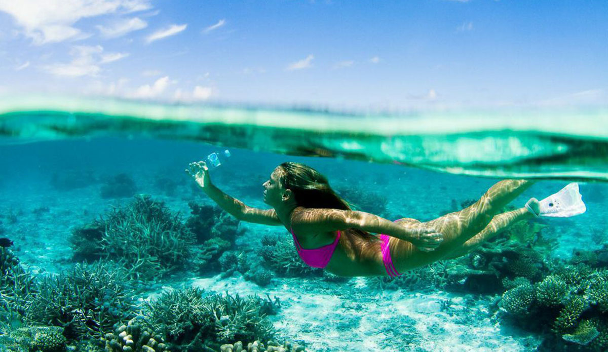 "It's sad to be swimming through paradise and find bottles from all over the world! Eventually they break down and fish eat them, then we eat them. This Odina bikini was made from 10 recycled plastic bottles. Photo: <a href=http://www.vivantvie.com/"">Sarah Lee</a>"