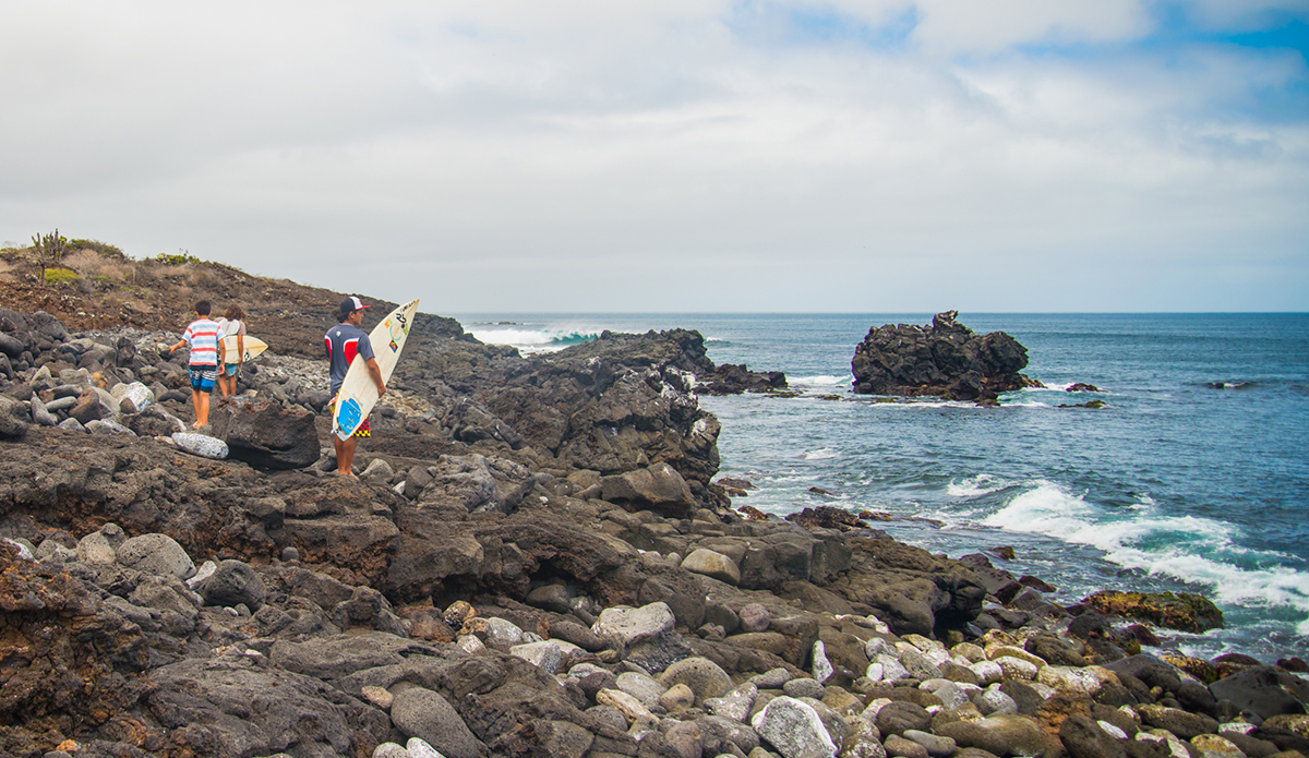 Andres and Wilson, Floreana locals, hiking their way to the surf. Photo: Maria Fernanda