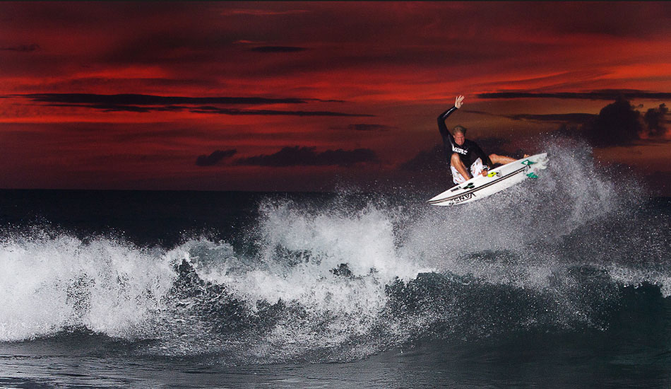 """This is Dane Gudauskas at small Pipe. Although this image looks like its been \""""photoshopped,\"""" it has not. A gorgeous sunset balanced with a single1200WS Profoto strobe popped at full power. I enclose the flash in contractor bags, and my assistant wears it in a backpack. If the backpack strap breaks (the flash setup is almost 50lbs), the contractor bag will hopefully prevent any electrical shock as the assistant often is wading in the shoreline to get the light source as close to the subject as possible. A bit dangerous in a way. You have one shot at full power, so it\'s exciting to anticipate the action and see what transcribes on the LCD after the shot is taken. 1/200@f11 ISO 400. Shot with the 70-200. Photo: <a href=\""""http://www.mikecoots.com\"""">Mike Coots</a>"""