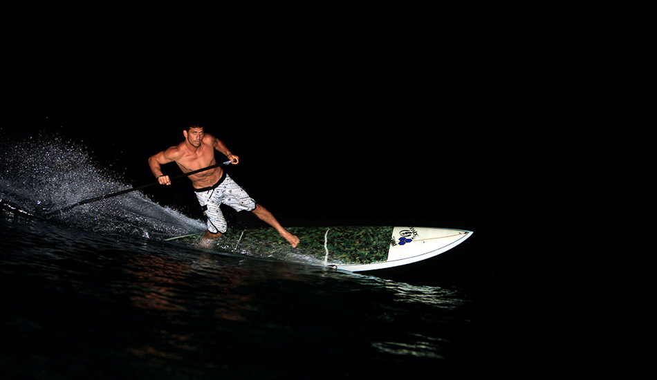 """Kamalei is one of my favorite althetes to shoot. He has a lot of talent and heart. I have probably shot him more than anybody else. Channel Island Surfboards sent him some SUPs and we had fun goofing around in the dark. Hardest part is getting the focus to catch. I shot it on another SUP without a water housing, but use a pelican case. On-camera flash shot at 1/200@f5.6 ISO 200. Photo: <a href=\""""http://www.mikecoots.com\"""">Mike Coots</a>"""