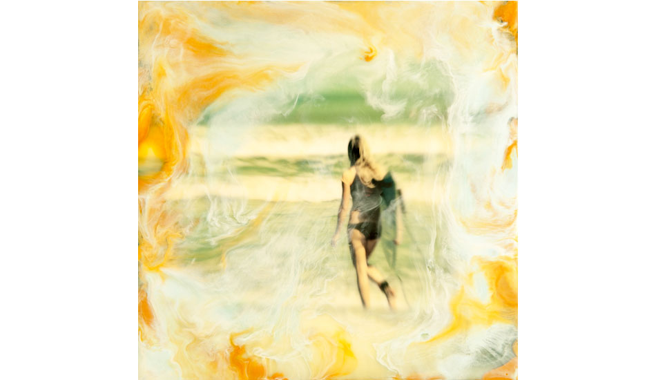 "This is an image of a young lady entering the water. I mounted a print on a 8X8 inch wood cradled panel, and cover it in beeswax and damar resin, and then added pigmented wax using a heat gun to create the swirls of color to give it a dreamlike appearance. Photo: <a href=""http://www.marksainwilson.com/?splash=1\"" target=_blank>Mark Wilson</a>"