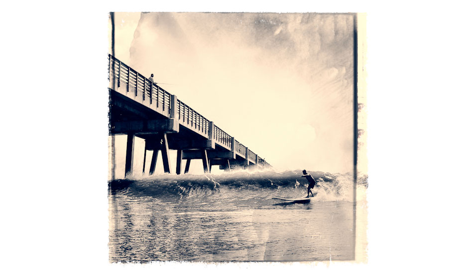 "This images is iconic because it depicts a local Mitch Kaufmann, (dubbed the mayor of Jax Beach, due to him knowing everyone, and having done a lot for our local surf community) aiming to shoot The Jacksonville Beach Pier on his 12 foot board. The pier has always been a wave magnet, and the waves here have produced a wealth of talent throughout the years. We have a very strong surf community here. Photo: <a href=""http://www.marksainwilson.com/?splash=1\"" target=_blank>Mark Wilson</a>"