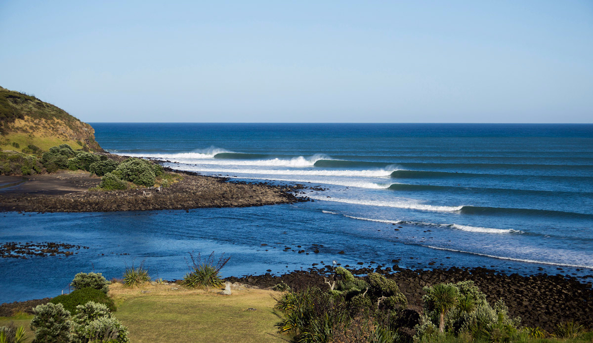 """Growing up on the East Coast on a diet of closeouts, it was like a dream come true the first time I surfed Raglan. The waves peel forever. I\'ve shot literally thousands of Raglan lineups, but this is definitely my favorite, as it really shows the mechanical uniformity of the place.  Photo: <a href=\""""http://www.rambo-estrada.com\"""">Rambo Estrada</a>"""