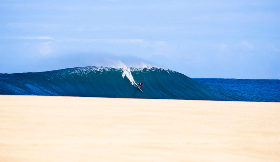 """Magnum Martinez on a Pipeline Bomb. I shot this well before all the sand had been washed away. Laying down and just waiting for it to all line up. The sand was gone soon after. One of my best Hawaii shots. Photo: <a href=\""""http://www.natesmithphoto.com/\"""" target=\""""_blank\"""" title=\""""Nate Smith Surf Photos\"""">Nate Smith</a>"""