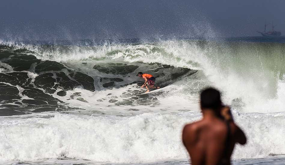 """The Champ, Parko, driving through a frothy barrel. Photo: <a href= \""""http://www.oakleyprobali.com/photos/\"""">Mick Curley</a>"""