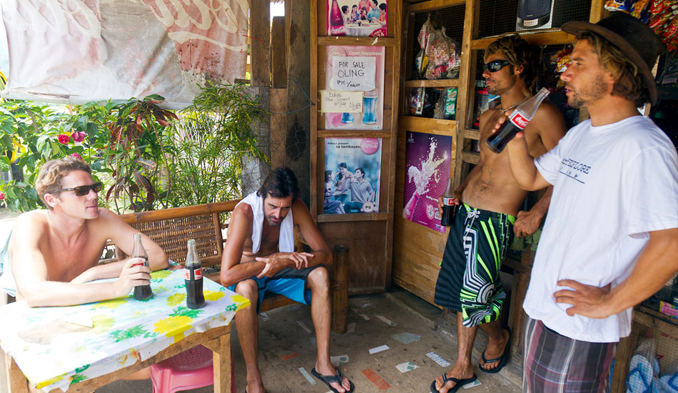 Team surfEXPLORE takes a break at a local shop. Cold Coca-Cola in recyclable bottles goes down well when it\'s hot and sweaty at 8am. Photo: Callahan/SurfExplore
