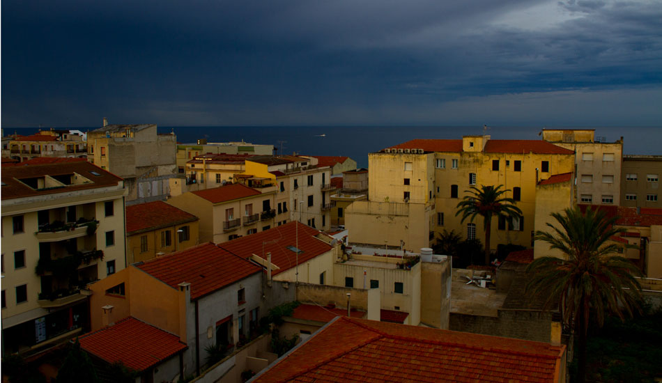 Alghero, Sardinia, as I sipped a coffee from the rooftop restaurant of my hotel the first morning I was there.  Had to go visit and surf the Med once in my life, and scored fun waves.  Photo: Rusty Long