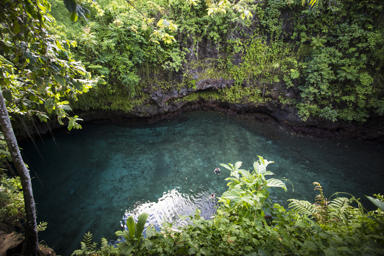 To Sua Ocean Trench, a giant swimming hole connected to the ocean by an ancient lava tube, rests a massive 100 feet in the earth. Those who brave the slick, steep wooden ladder down are rewarded with cool water and an other-worldly jungle experience.