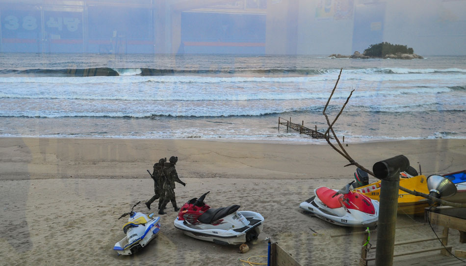 """All fences are patrolled day and night by the young soldiers.  Lucky these guys weren't surfers. Photo: <a href=\""""http://www.shannonaston.com/\"""" target=_blank>Shannon Aston</a>."""