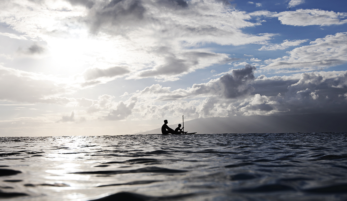 A father teaches his son the finer points of paddling. Maui, Hawaii. Photo: Sheldon Magner
